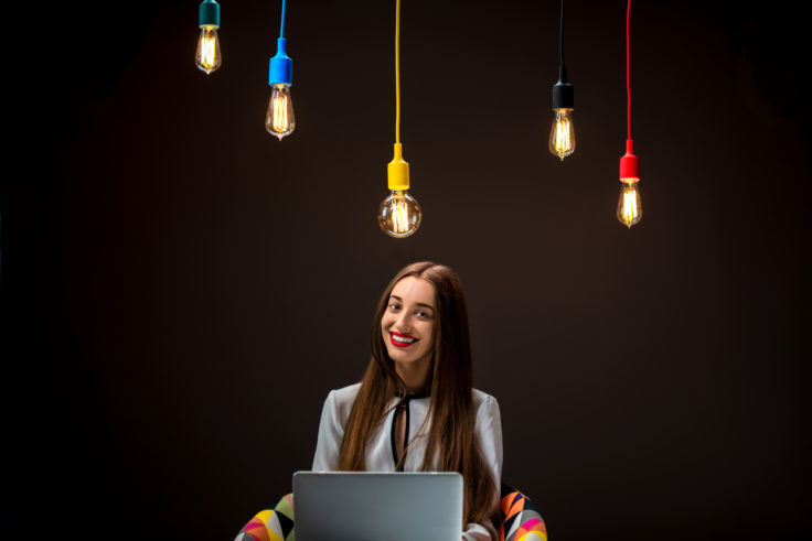 Woman having idea working with laptop